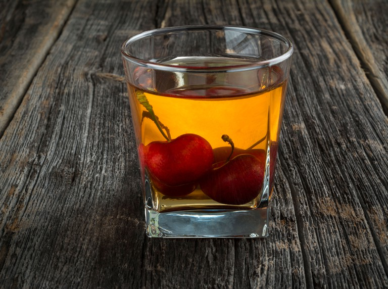 Manhattan or other whiskey cocktail, with cherries submerged