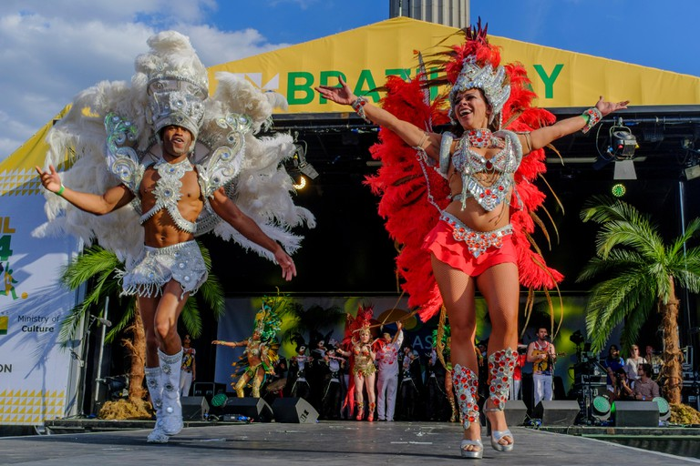 Dancers from Paraiso School of Samba perform on stage as part of the Brazil Day festival in Trafalgar Square, London UK