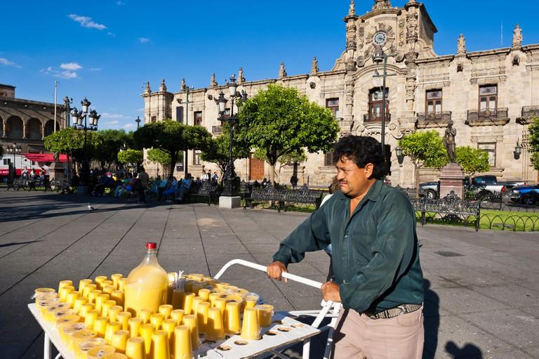 Mexico, Jalisco state, Guadalajara, Plaza de Armas and the baroque Governor's Palace (Palacio de Gobierno) in the historical