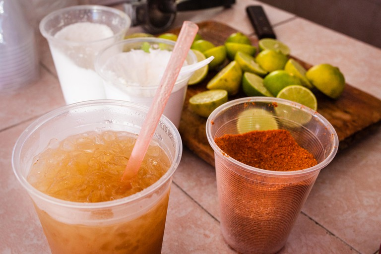 Salt, lime and chile are ready to be added to a glass of Tejuino, a refreshing corn based drink, in Mazatlan, Sinaloa, Mexico.