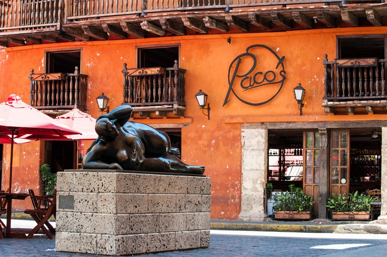 Statue of a fat woman reclining by Fernando Botero in the Plaza de Santo Domingo, Cartagena de Indias, Colombia