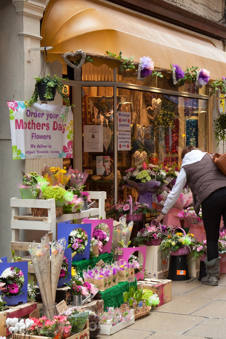 "Southport, Merseyside, UK. 14th March, 2014.  Shoppers in ""Mothers Day Mode. The florists, florist, flower, flower shop, retail, working, front view, occupation, small business, entrepreneur, horizontal, business, bouquet, store, at The Flower Shop are g"