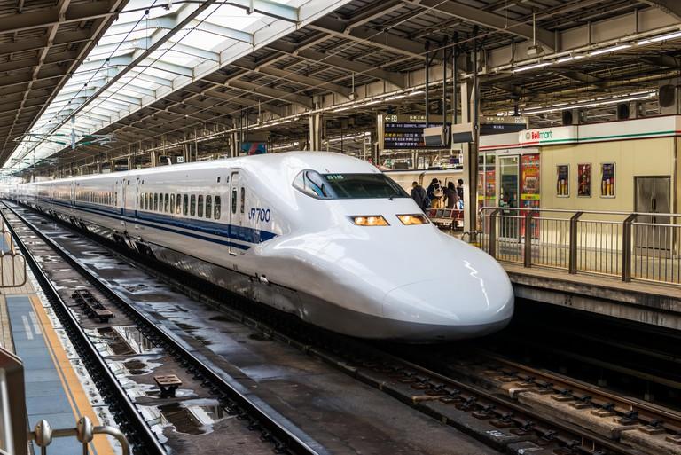 A Shinkansen train pulls into Shin Osaka Station
