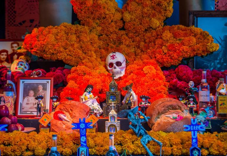 Traditional Mexican altar installation at the Dia De Los Muertos celebration in Oaxaca , Mexico
