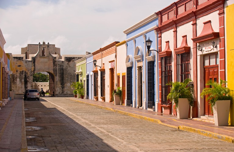 Colourful colonial houses in a street leading to a city gate of San Francisco de Campeche, Mexico