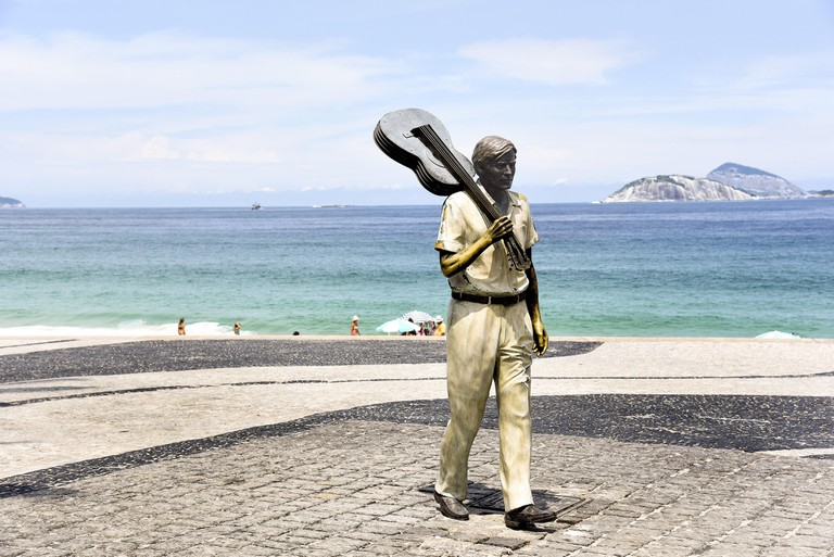 Tom Jobim conductor statue on the edge of Ipanema Beach, at the time of Arpoador, south side. Image shot 03/2015. Exact date unknown.