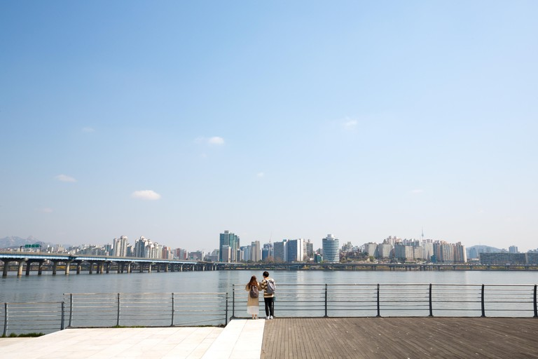 Couple overlooking Seoul city & Han river