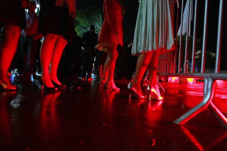 Women queue to enter a nightclub in Cannes