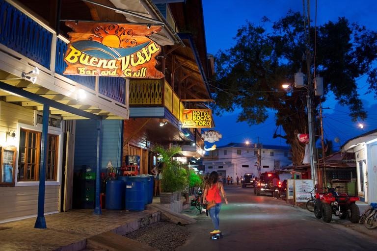 Panama, Bocas del Toro Province, Colon Island (Isla Colon),  main street. Bocas del Toro, Panama by night. Restaurants and hotels.  Buena Vista bar an