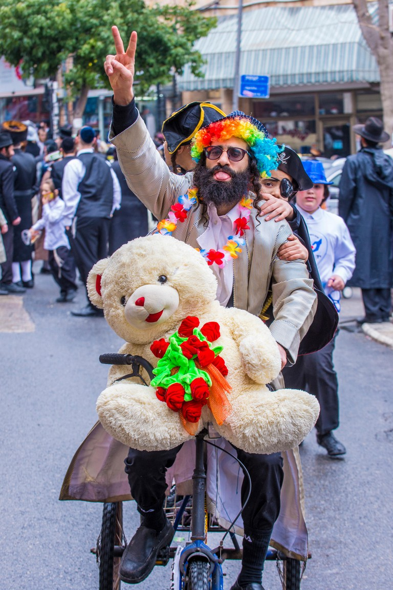 JERUSALEM - MARCH 13 : Ultra Orthodox man during Purim in Mea Shearim Jerusalem on March 13 2017 , Purim is a Jewish holiday celebrates the salvation
