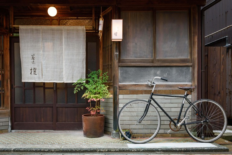 Bicycle parking on a footpath in front of the house in Japan