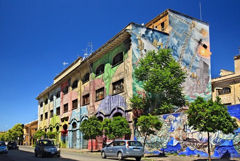 Mural by famous street artist Blu at Via del Porto Fluviale, Ostiense, Rome, Italy