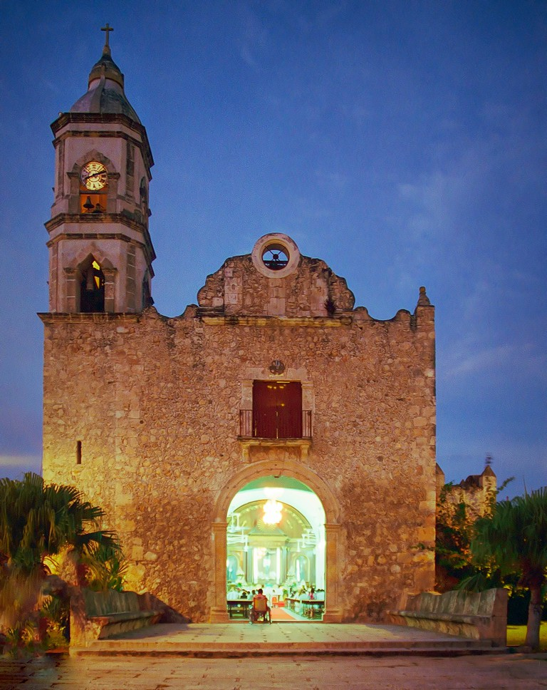 Evening service in process at the Church of the Black Christ which is also known as San Roman Church in Campeche City, Campeche, Mexico.