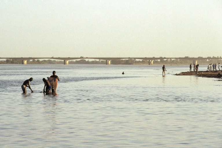 Washing in the Nile at Khartoum, the confluence of the White and Blue Nile Rivers.