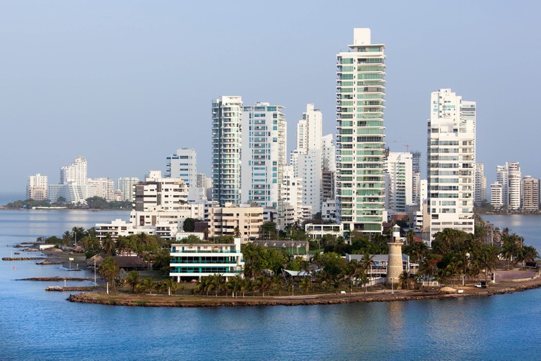 The view of Castillogrande residential district with a lighthouse in a morning light (Cartagena, Colombia).