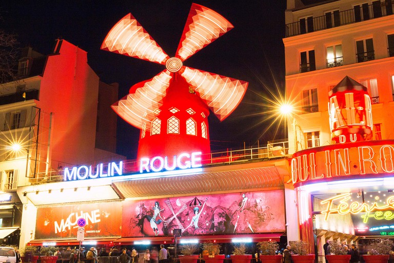 The Moulin Rouge , Paris, France. It is a famous cabaret built in 1889, locating in the Paris red-light district of Pigalle