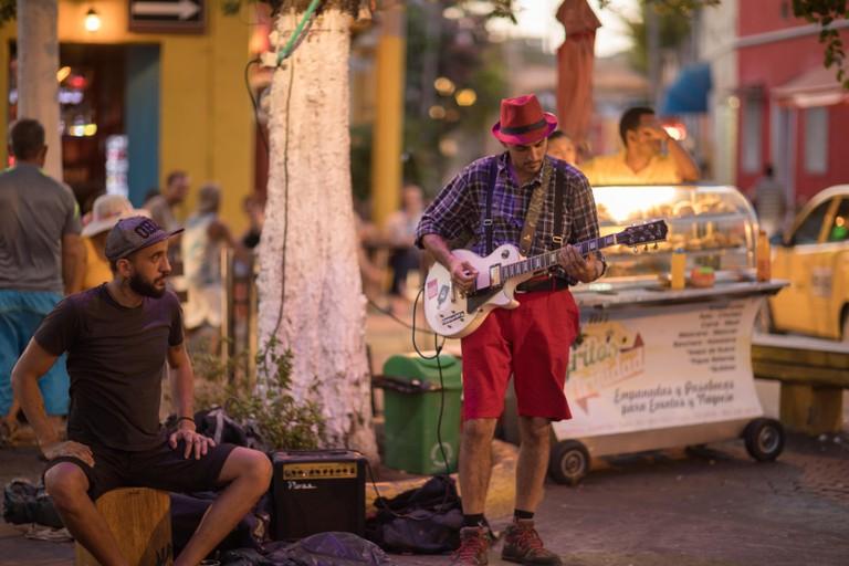 A busker in the colourful Plaza de la Santesima Trinidad, Getsemani, Cartagena, Colombia