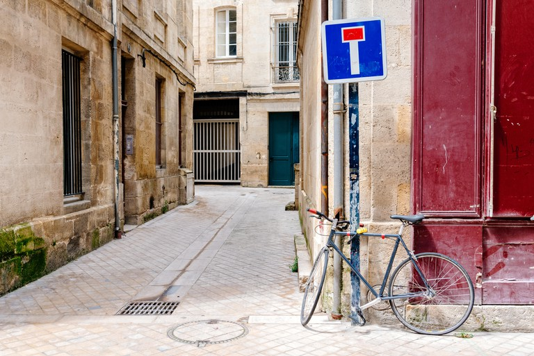 Bicycle parked in old narrow street in the city centre