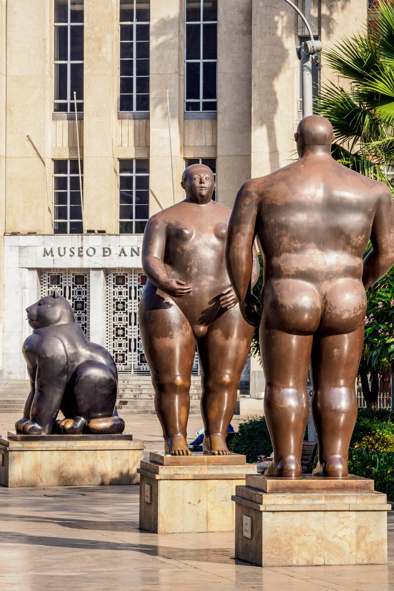 Sculptures by Fernando Botero in front of Museum of Antioquia, Plaza Botero, Medellin, Antioquia Department, Colombia