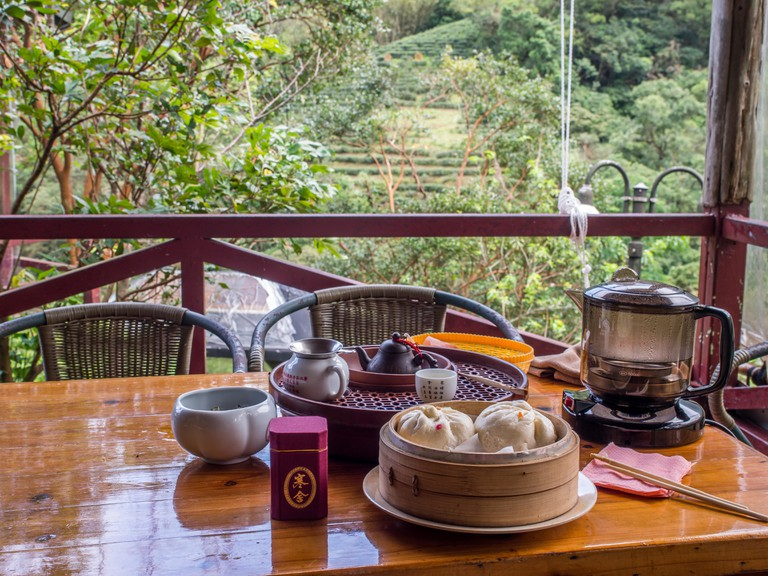 A gongfu tea table with accessories in a local tea house on the hills of Maokong
