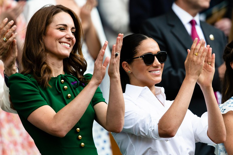 London, UK, 13th July 2019: Catherine, Duchess of Cambridge and Meghan, Duchess of Sussex attend day 12 of the Wimbledon Tennis Championships at All England Lawn Tennis and Croquet Club. Credit: Frank Molter/Alamy Live news