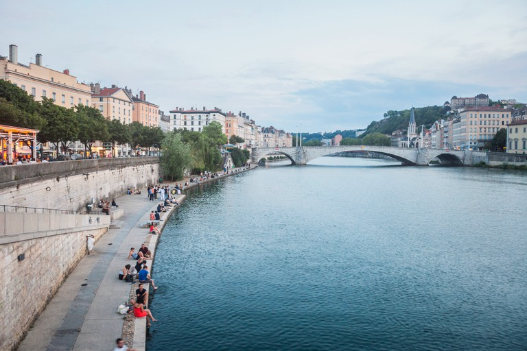 LYON, FRANCE - JULY 17, 2019: Panorama of Saone river and the Quais de Saone riverbank and riverside in the city center of Lyon, with a focus on the P