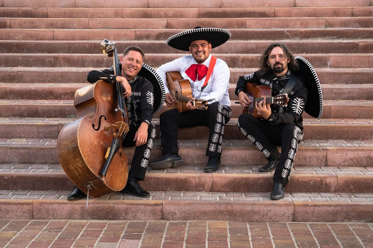 Mexican musicians mariachi band give street concert