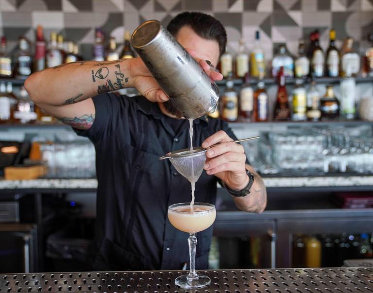 Bartender prepares the Hemingway Daiquiri