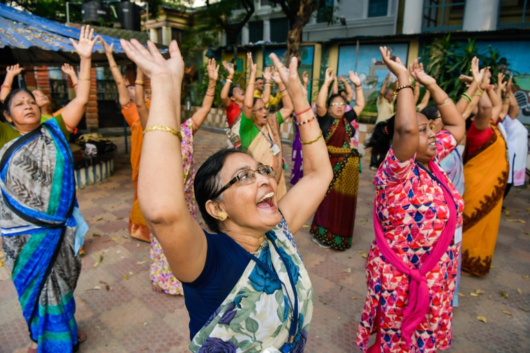 Senior People enjoy laughter yoga session at college square laughing club in kolkata.Laughter yoga helps to increase happiness, but it also strengthens the immune system, reduces pain and lowers stress. It combines simulated laughter exercises with gentle