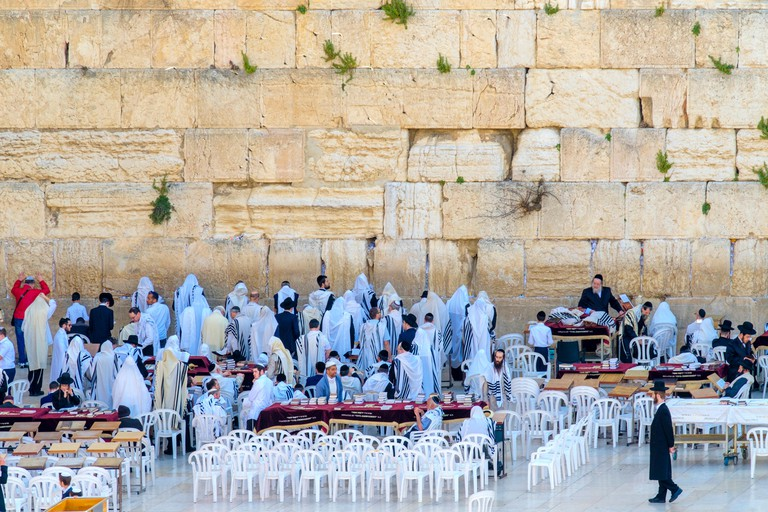 Jewish men praying at the Western Wall on the Kotel Plaza on the last day of Passover (Pesach), Old City, Jerusalem, Israel.