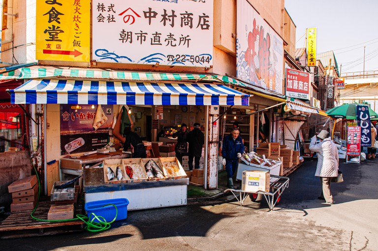 Japanese seafood shops with sellers and buyers at Hakodate Asaichi fish market