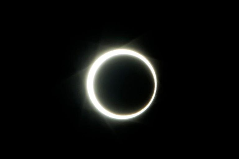Batam, Indonesia. 26th Dec, 2019. An annular solar eclipse is seen at Engku Putri Island in Batam, Indonesia, Dec. 26, 2019. Credit: Teguh Priatna/Xinhua/Alamy Live News