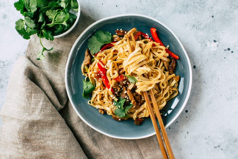 Asian food, udon noodles with vegetables, healthy vegetarian menu