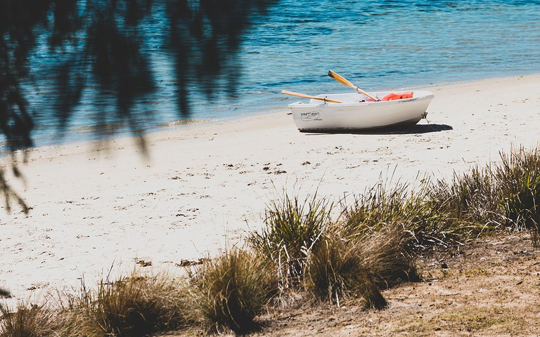 wild Tasmanian landscape and pristine turquoise water of the Derwent River as seen from Legacy Beach wal