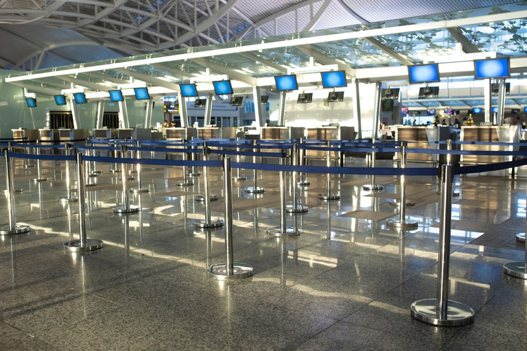 Empty check-in desks at the airport terminal.