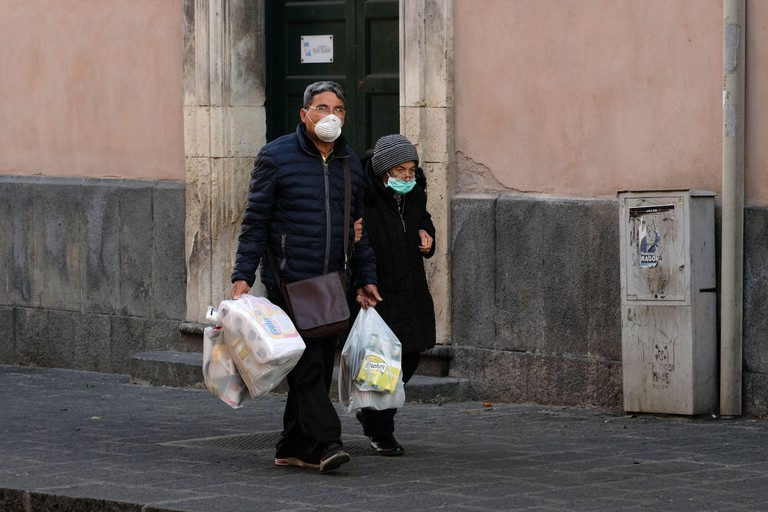 People wearing protective masks in Italy