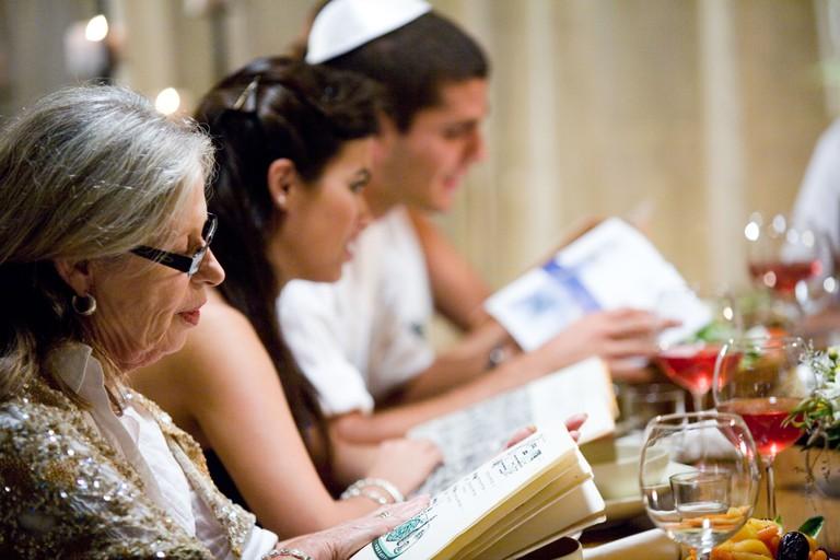 Reading the Haggadah.