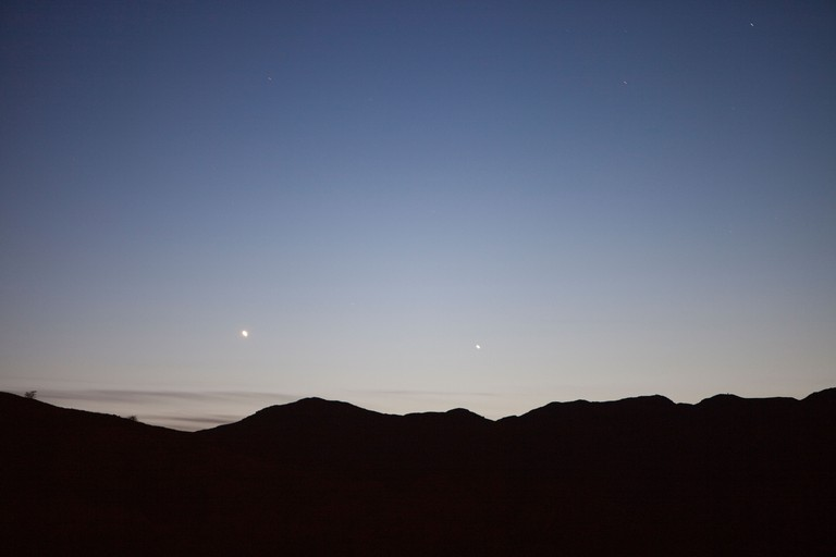 The planets Venus and Mercury in the dusk sky over Loughrigg in the Lake District, UK