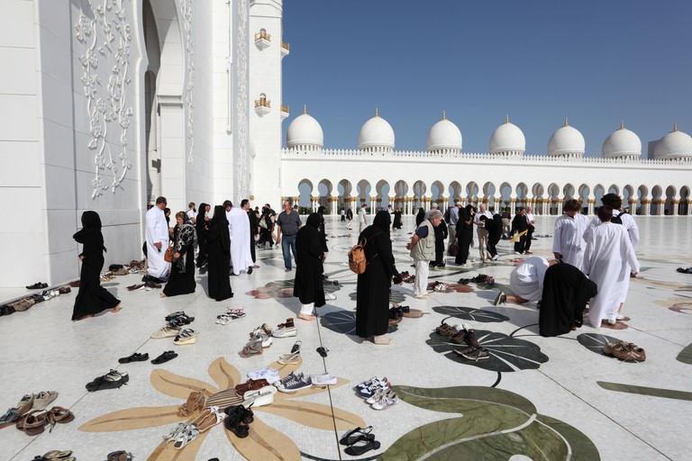 Visitors of the Sheikh Zayed Mosque in Abu Dhabi, United Arab Emirates