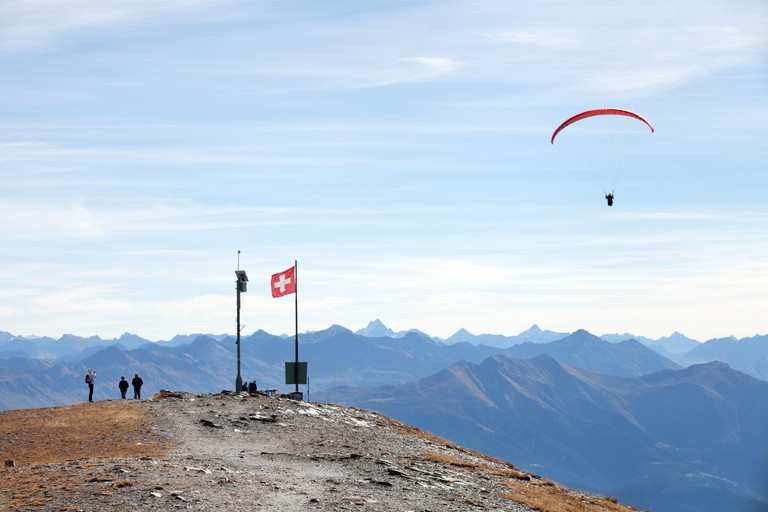 Walking and paragliding, Swiss Alps at Flims, Graubunden, Switzerland Europe