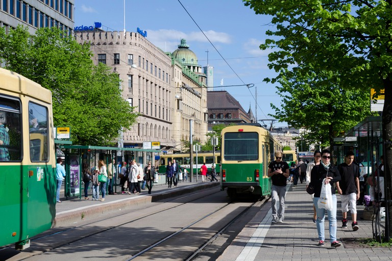 Trams at tram stop in central Helsinki, Finland, Scandinavia, Europe