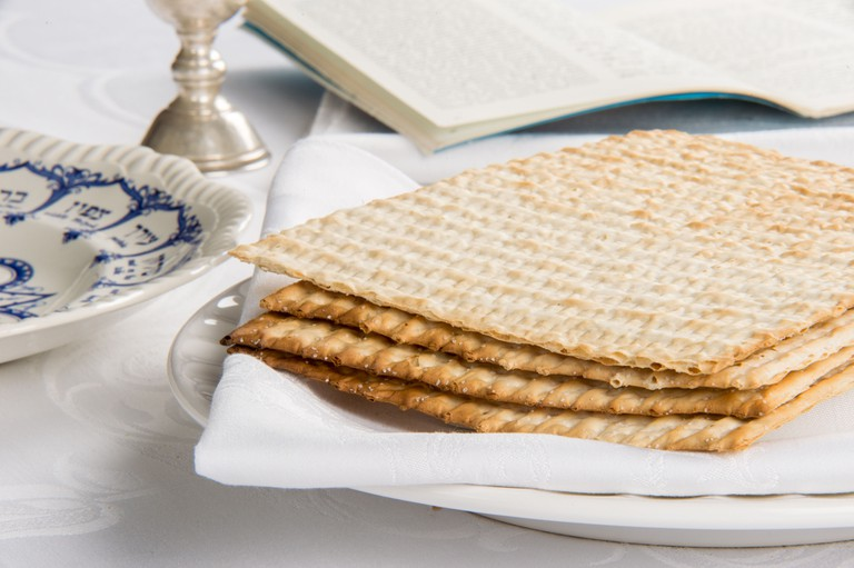 Closeup of Matzah on Plate which is the unleaven bread served at Jewish Passover dinners