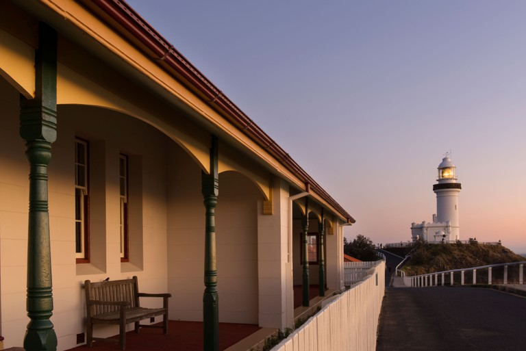 Lighthouse keeper's cottage and lighthouse at Byron Bay at sunrise.