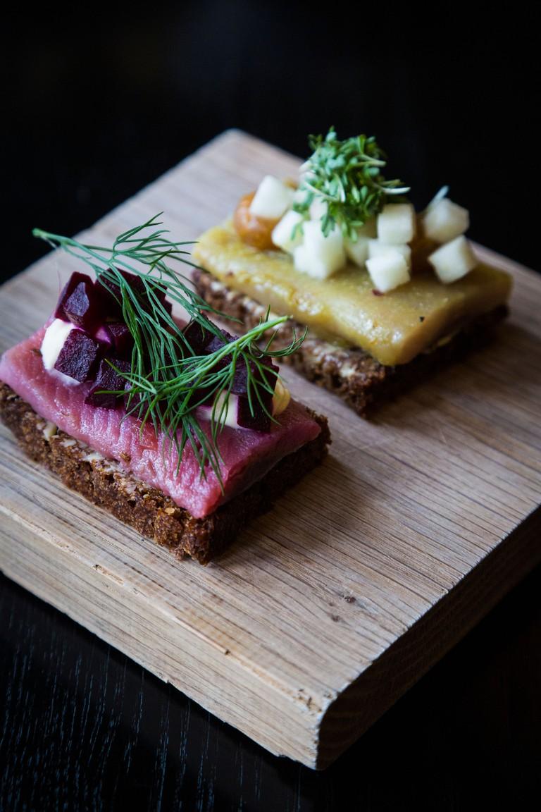 Small danish smorrebrod of herring fish served as part of the Ammanns Lunch, Aamanns Restaurant, Copenhagen, Denmark.