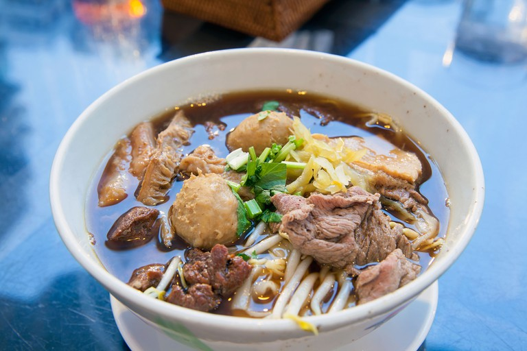 Beef Noodle Soup with Meatballs Sliced Meat Intestines Garnished with Cilantro and Ginger
