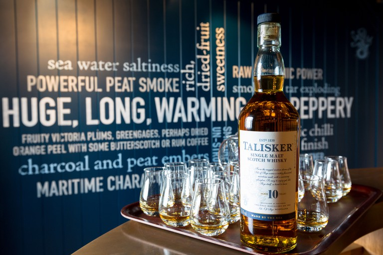 Bottle of 10 year Talisker single malt Scotch Whisky glasses for tasting on visitors tour at Distillery, Isle of Skye, SCOTLAND