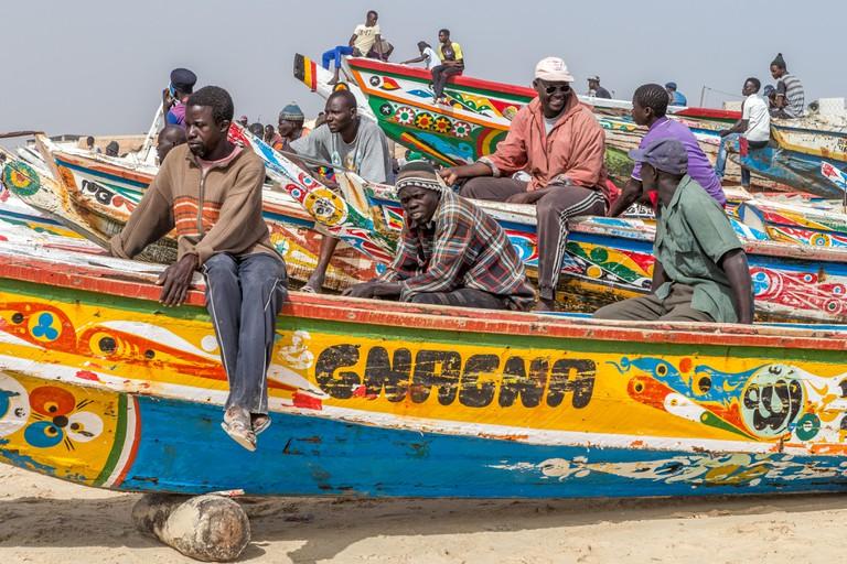 Local Fishermen & Pirogues fishing boats Kayar Senegal