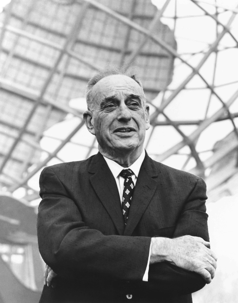 Robert Moses in front of the New York's World Fair signature structure, the Unisphere. August 1964. Moses was a behind the scenes urban planner who drew his power from leadership of numerous public NYC authorities, such as New York City Housing Authority