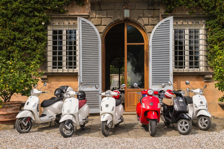 Vespa Italian scooters outside Tenuta di Valgiano, vineyard and winery, Valgiano, Tuscany, Italy