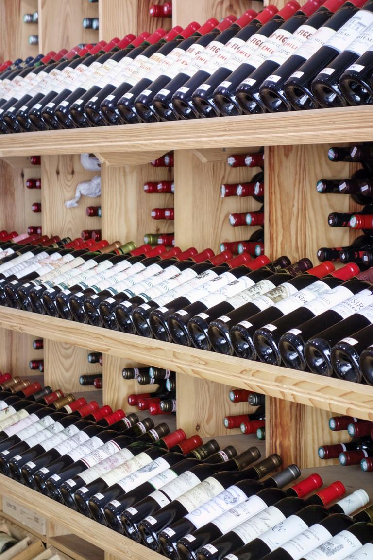 Racks of Bordeaux wines on sale, Saint Emillion, France